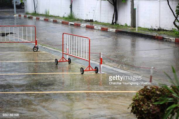 barricades on road during rain - barricade stock photos and pictures