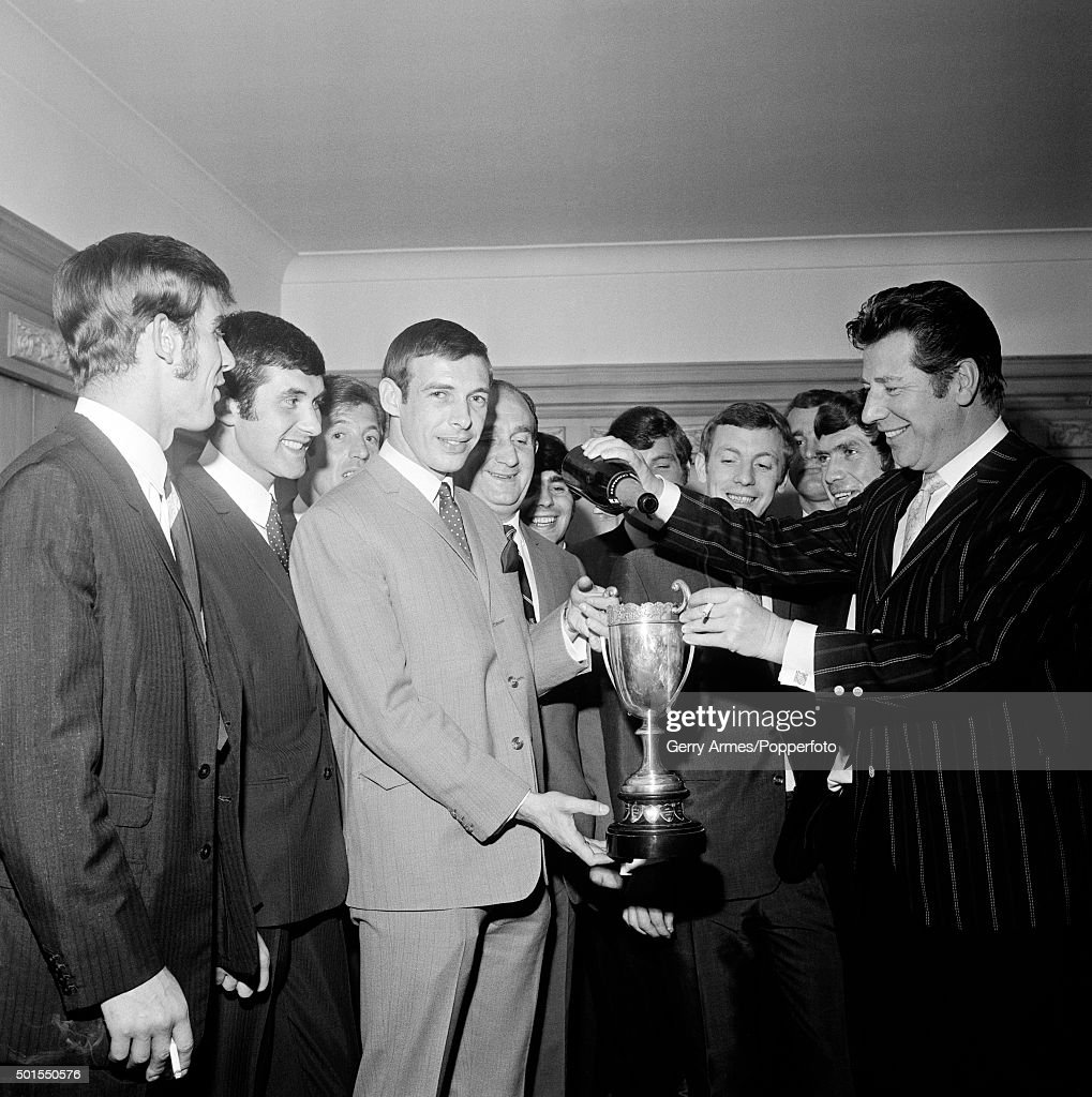 Barrie Hole has been voted Player of the Year by the Aston Villa supporters club, and he holds the 'Terrace Trophy' as Max Bygraves fills it with champagne at the Penns Hall Hotel in Birmingham, 12th April 1969.