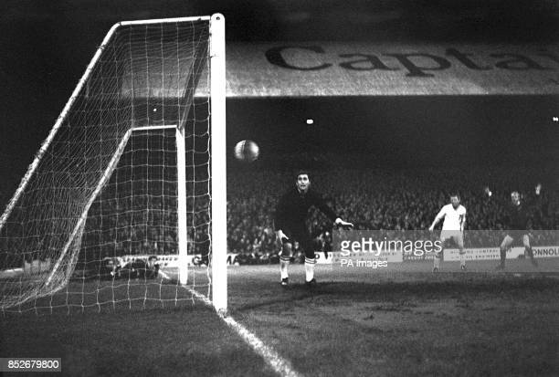 Barrie Jones raises his arms in triumph as he sees his shot enter the net to give Cardiff the first and winning goal of first leg of the European Cup...