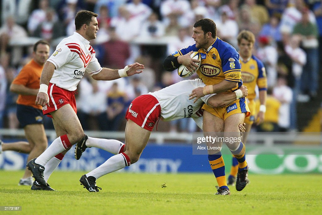 Barrie McDermott of Leeds Rhinos is tackled by Mike Bennett of St Helens during the Tetley's Super League match between Leeds Rhinos and St Helens held on June 13, 2003 at the Headingley Stadium in Leeds, England. Leeds Rhinos won the match 20-14.