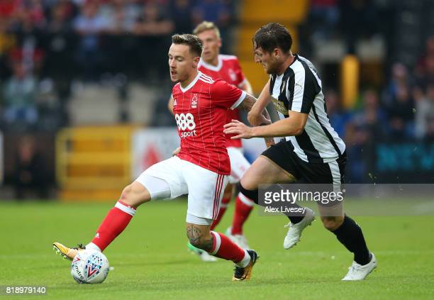 Barrie McKay of Nottingham Forest beats Matt Tootle of Notts County during a preseason friendly match between Notts County and Nottingham Forest at...