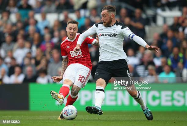 Barrie McKay of Nottingham Forest shoots past Richard Keogh of Derby County during the Sky Bet Championship match between Derby County and Nottingham...