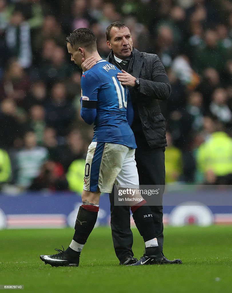 Barrie McKay of Rangers is consoled by Celtic manager Brendan Rogers at full time during the Rangers v Celtic Ladbrokes Scottish Premiership match at Ibrox Stadium on December 31, 2016 in Glasgow, Scotland.
