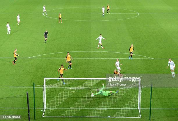 Barrie McKay of Swansea City has his shot saved by Callum Burton of Cambridge United during the Carabao Cup Second Round match between Swansea City...