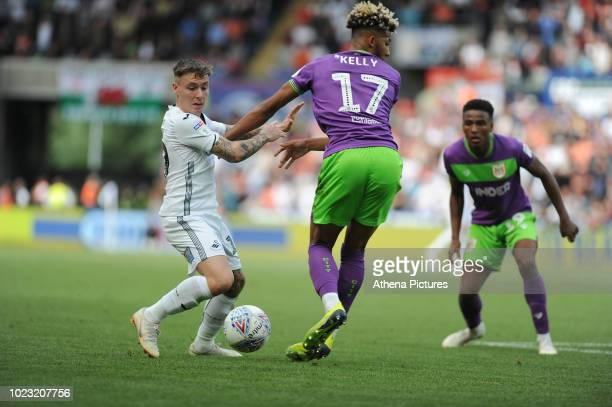 Barrie McKay of Swansea City vies for possession with Lloyd Kelly of Bristol City during the Sky Bet Championship match between Swansea City and...
