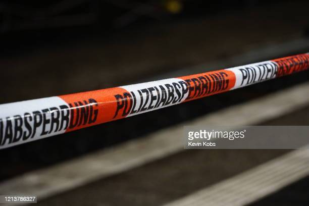 barrier tape of the german police with rain drops at a train station in berlin, germany. - barricade stock pictures, royalty-free photos & images