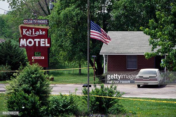 Barrier tape weaves past a flag at half mast at the Kel Lake Motel where Gary Land was arrested He is thought to have information on the Oklahoma...