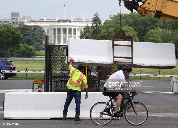 Barriers and temporary fencing are removed from the south side of the White House complex on June 10, 2020 in Washington, DC. The barriers were...