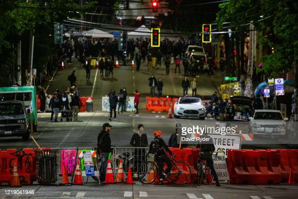Barriers are seen on a street leading to the Seattle Police Departments East Precinct on June 9, 2020 in Seattle, Washington. Protests have continued...
