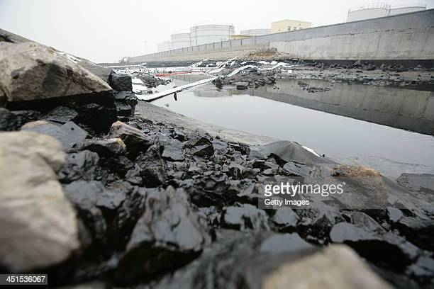 Barriers are seen to protect the sea from an oil spill after a oil pipeline exploded on November 23 2013 in Qingdao China The death toll from the...