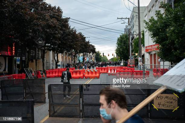 Barriers block a roadway as demonstrators hold a rally and teach-in outside of the Seattle Police Departments East Precinct, which has been boarded...