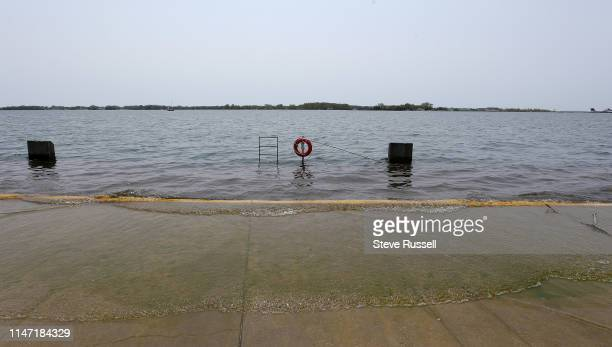 Barriers, driftwood, and caution tape line the Waterfront Trail at HTO Beach as the High water levels in Lake Ontario have portions of Toronto's...
