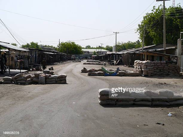 Barriers made of sandbags are seen in the street leading to local churches in Maiduguri Nigeria on May 26 2013 Cars are no longer allowed to approach...