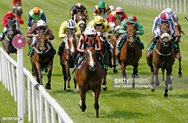 Barring Decree ridden by Keagan Latham wins the Axminster Curragh Carpets Handicap during the Abu Dhabi Irish 2000 Guineas Day at Curragh Racecourse...