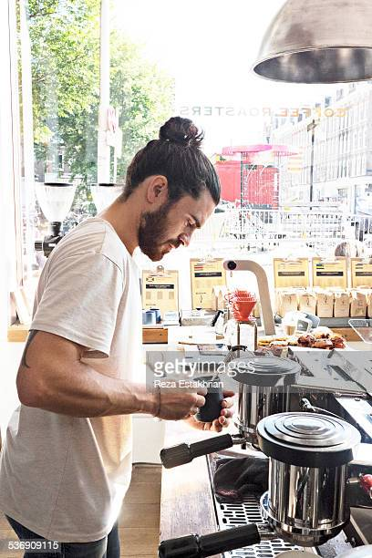 barrista makes a coffee - topknot stock pictures, royalty-free photos & images