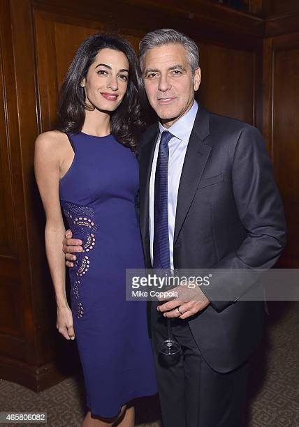 Barrister Amal Clooney and actor George Clooney attend The 100 LIVES initiative to express gratitude to the individuals and institutions whose heroic...
