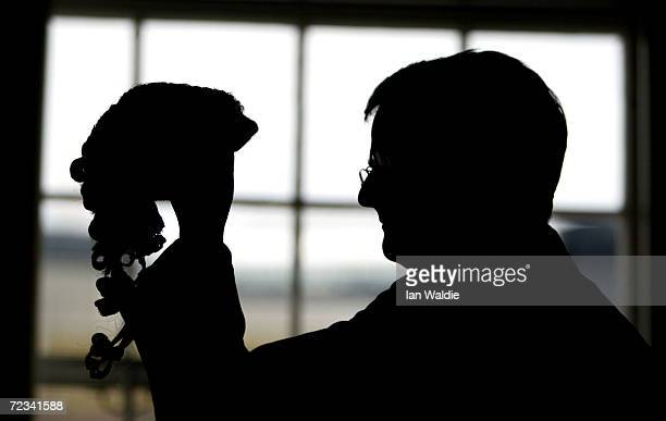 Barrister checks his wig prior to British Home Secretary David Blunkett announcing changes to sentencing laws May 7, 2003 in London, England....