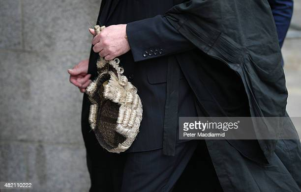 A barrister holds his wig as he arrives at The Old Bailey on July 27 2015 in London England Barristers in England and Wales are beginning industrial...