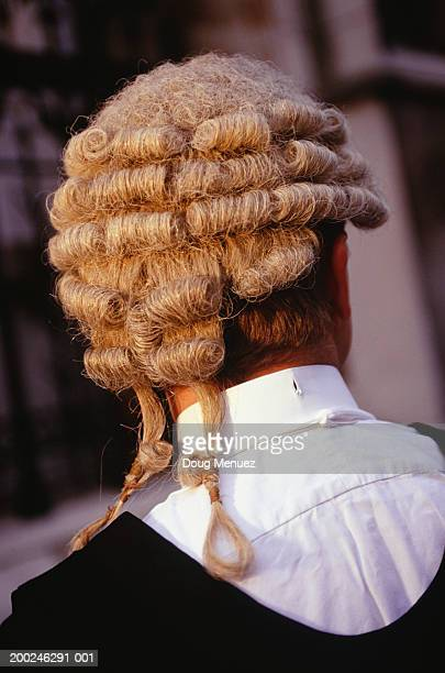 Barrister in uniform, outdoors, rear view, (Close-up)