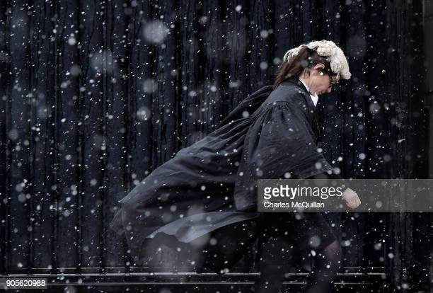 Barrister makes her way into Belfast High Court through heavy snow on January 16, 2018 in Belfast, Northern Ireland. The Met Office has placed an...