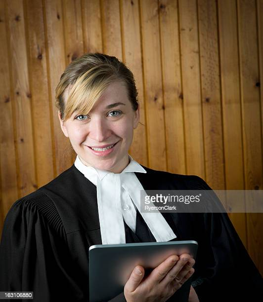 Barrister or Lawyer in Traditional Robes with a Tablet Computer