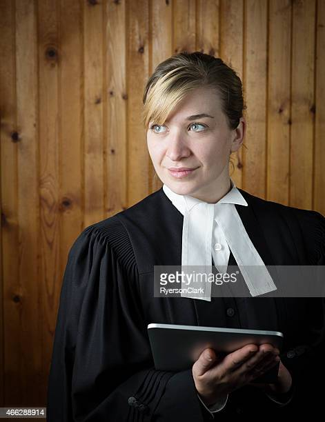 Barrister or Lawyer in Traditional Robes with an Electronic Notebook