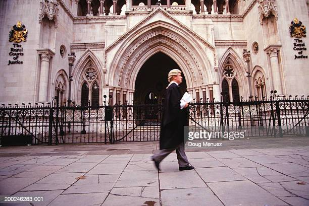 Barrister walking in front of court building, side view