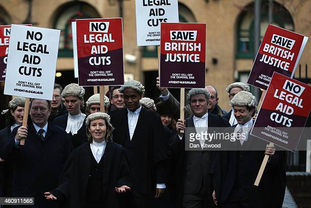 Barristers line up for a photocall outside Southwark Crown Court on January 6 2014 in London England Barristers and solicitors in England and Wales...