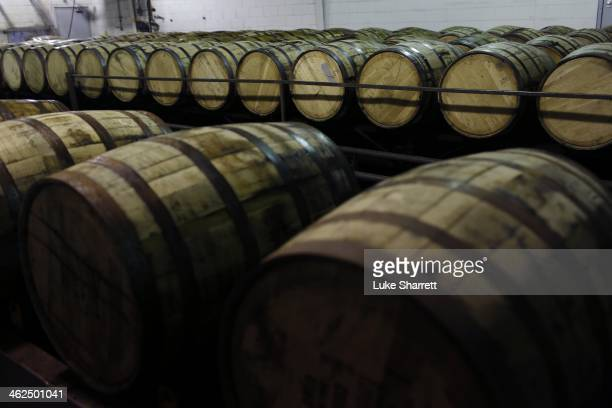 Barrles of Jim Beam Bourbon wait to be drained at the Jim Beam Bourbon Distillery on January 13 2014 in Clermont Kentucky Japanese company Suntory...