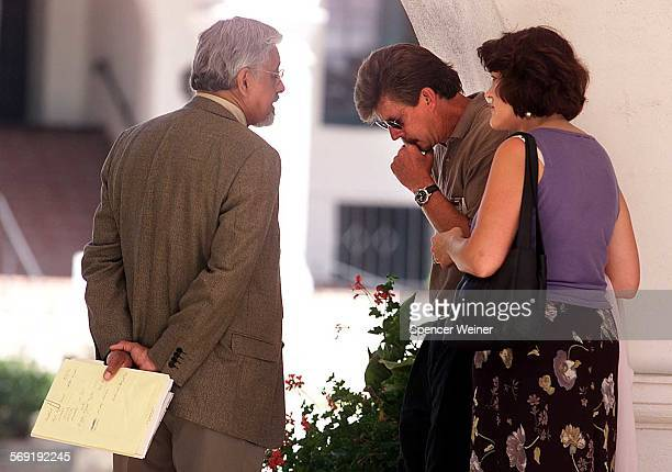 –– Barron and Melissa Rugge parents of one of the suspects talk to defense attorney James Crowder Barron Rugge center and wife Melissa Rugge listen...