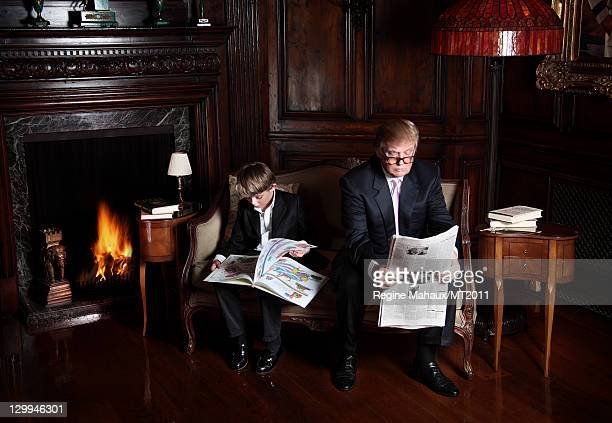 Barron Trump and Donald Trump pose during a photo shoot at the MaraLago Club on March 26 2011 in Palm Beach Florida Melania%u2019s clothes by Chanel...