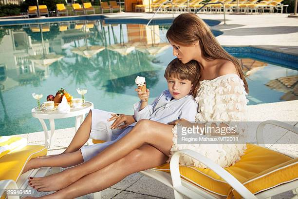 Barron Trump and Melania Trump pose during a photo shoot at the MaraLago Club on March 26 2011 in Palm Beach Florida Melania's clothes by Chanel...