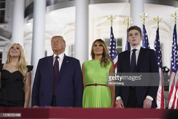 Barron Trump, from right, U.S. First Lady Melania Trump, U.S. President Donald Trump, and Tiffany Trump, stand in front of the White House during the...