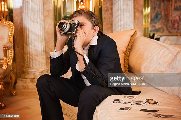 Barron Trump is using the new FUJIFILM instax mini 90 as he is photographed at Trump Tower on January 6 2016 in New York City