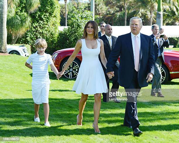 Barron Trump Melania Trump and Donald Trump attend Trump Invitational Grand Prix at MaraLago on January 6 2013 in Palm Beach Florida