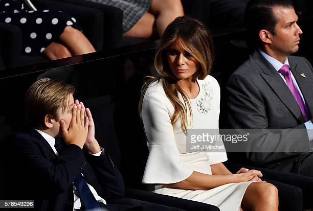 Barron Trump Melania Trump and Donald Trump Jr listen to Republican presidential candidate Donald Trump deliver his speech on the fourth day of the...