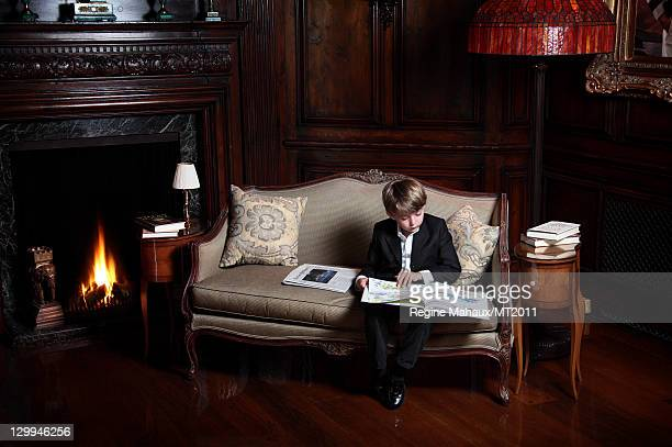 Barron Trump poses during a photo shoot at the MaraLago Club on March 26 2011 in Palm Beach Florida Melania's clothes by Chanel makeup by Tina...