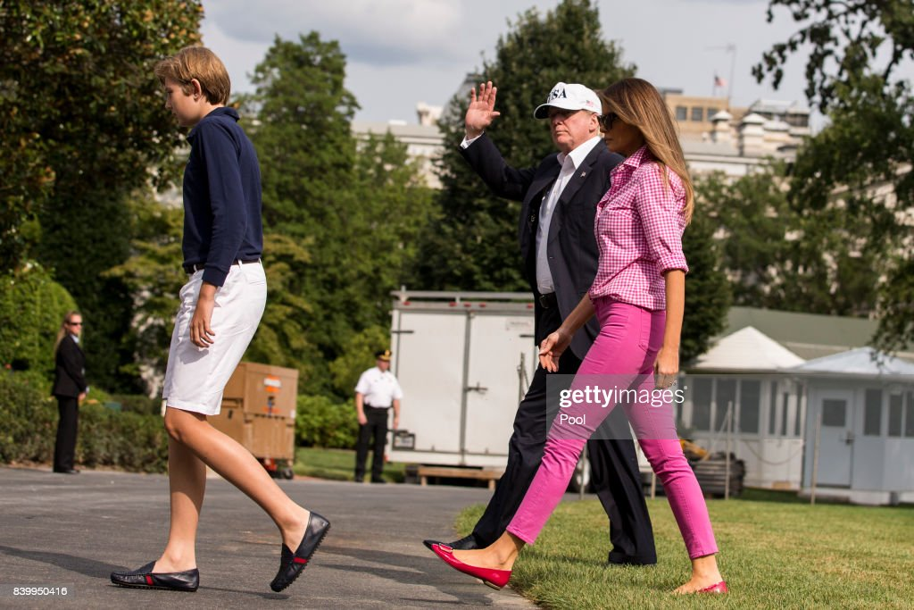 Barron Trump, 11, President Donald J. Trump and first lady Melania Trump walks across the South Lawn August 27, 2017 in Washington, DC. Trump is returning to the White House after a weekend at Camp David.