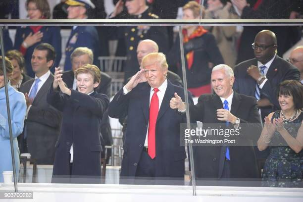 Barron Trump President Trump Vice President Pence and Karen Pence watch the inaugural parade at Lafayette Square by The White House in Washington DC...