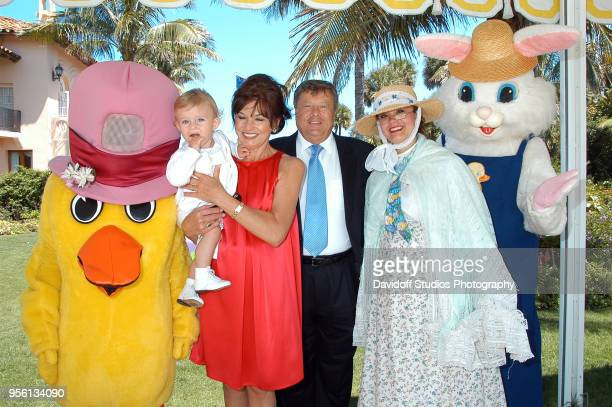 Barron Trump second from left is held by grandmother Amalija Knavs who stands next to husband Viktor Knavs during Easter Sunday events at the...