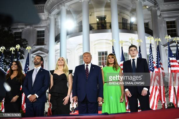 Barron Trump, US First Lady Melania Trump, US President Donald Trump, Tiffany Trump, Donald Trump Jr. And Kimberly Guilfoyle watch fireworks at the...