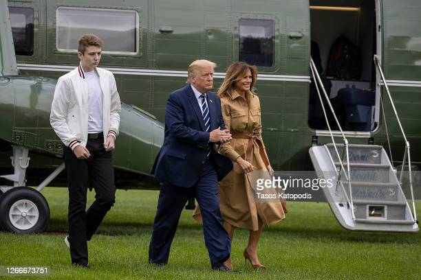 Barron Trump, US President Donald Trump and First lady Melania Trump walk on the South Lawn of the White House on August 16, 2020 in Washington, DC....