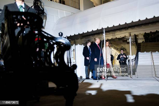 Barron Trump US President Donald Trump and US first lady Melania Trump walk to Marine One on the South Lawn of the White House December 20 in...