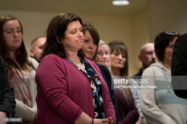 Family members of Jayme Closs including her aunt Kelly Engelhardt in front stood behind the speakers at a press conference after the sentencing of...