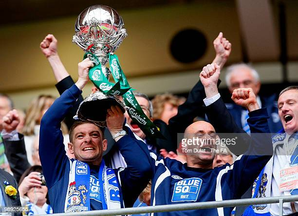 Barrow managers Darren Sheridan and Dave Bayliss celebrate lift the trophy after winning the the FA Carlsberg Trophy Final match between Barrow and...