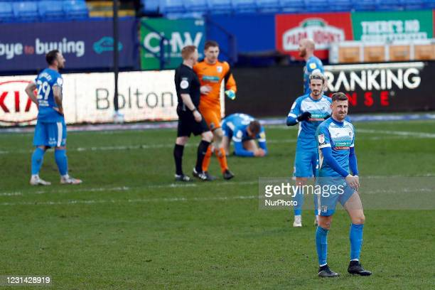 Barrow players dejected after the injury time winner during the Sky Bet League 2 match between Bolton Wanderers and Barrow at the Reebok Stadium,...