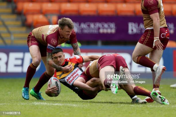 Barrow Raiders Tee Ritson is tackled by Sheffeld Eagles Ben Hellewell and Sheffeld Eagles Anthony Thackeray during the Betfred Championship Summer...