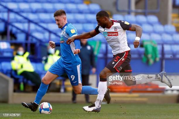 Barrow Scott Quigley battles with Boltons Ricardo Santos during the Sky Bet League 2 match between Bolton Wanderers and Barrow at the Reebok Stadium,...