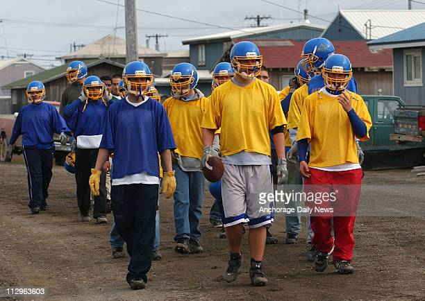 Barrow Whalers football players make their way from school to a practice field for walkthrough drills the day before their inaugural game August 18...