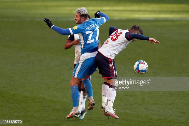 Barrows Brad Barry clashes with Boltons Declan John during the Sky Bet League 2 match between Bolton Wanderers and Barrow at the Reebok Stadium,...